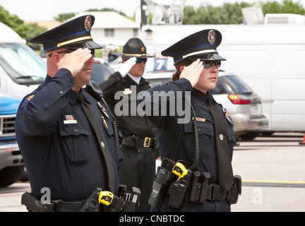officers salute during funeral for Austin Police Officer Jaime Padron, who was killed in the line of duty in a full - Stock Photo
