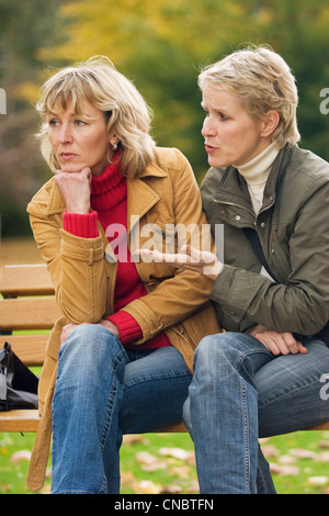 Two women arguing - Stock Photo