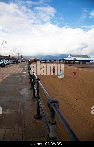 Cleethorpes, Lincolnshire, Pier a traditional victorian pier which is now a nightclub & restaurant people on beach - Stock Photo