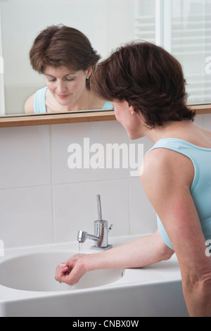 Woman cooling down with cold water - Stock Photo
