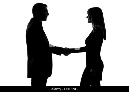 one caucasian couple man and woman handshake in studio silhouette isolated on white background - Stock Photo