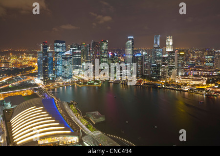 Singapore, Marina Bay, Central Business District and the shopping mall The Shoppes, seen from the SkyPark at Marina - Stock Photo