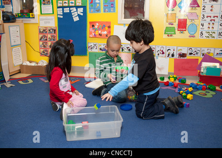 Preschool children in classroom - Stock Photo