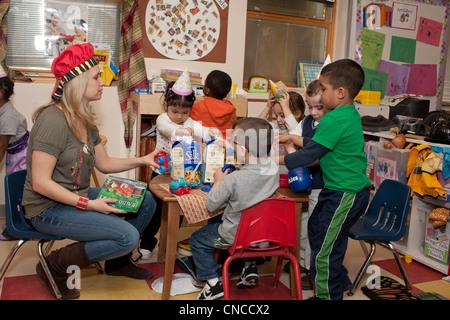 Preschool children in classroom - Stock Photo