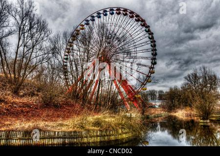 An abandoned big wheel funfair in Treptower Park (aka Spreepark) in ex East Berlin - Stock Photo