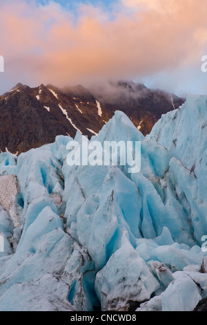 Close up of Raven Glacier with evening light hitting clouds in the background, Chugach State Park, Southcentral - Stock Photo