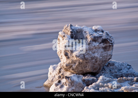 View of a large chunk of stranded ice with blurred motion ice in the background, Turnagain Arm, Chugach State Park, - Stock Photo