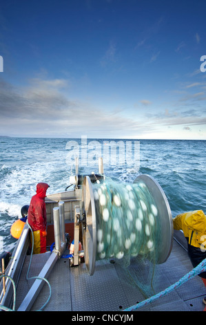 The crew casts out the first set of a gillnet in Ugashik Bay, Bristol Bay region, Southwest Alaska, Summer - Stock Photo