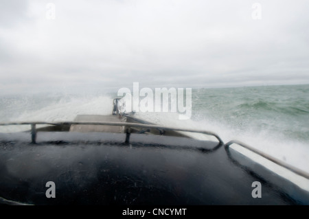 View from the cabin of waves crashing over the bow of a drift net boat in Bristol Bay near Naknek, Soutwest Alaska, - Stock Photo