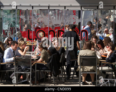 Many people enjoying the sun during their lunch break on Place du Luxembourg in Brussels, Belgium - Stock Photo