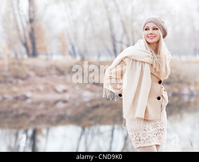 blond woman in the autumn park - Stock Photo