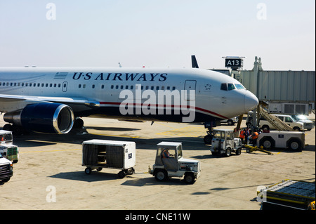 USAirways commercial jet parked at a gate at the Denver International Airport, Denver, Colorado, USA - Stock Photo