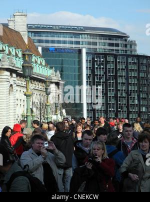 Tourists on Westminster bridge London - Stock Photo