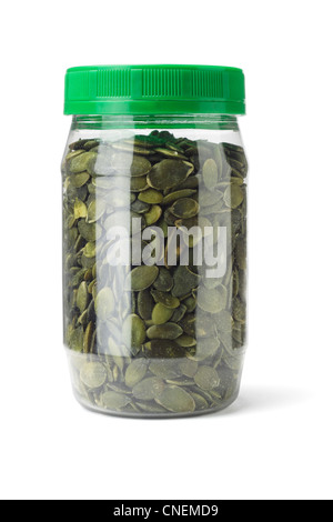 Dried Pumpkin Seeds in Plastic Bottle on White Background - Stock Photo