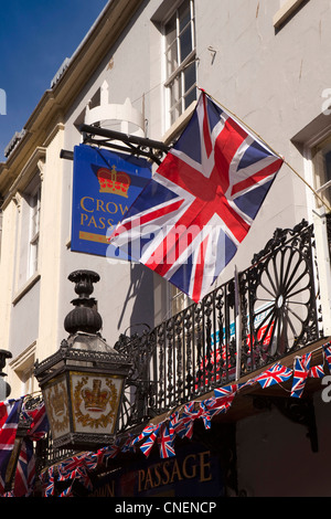 UK, England, Worcestershire, Worcester, Broad Street Union Jack flags flying on balcony of Crown Hotel - Stock Photo