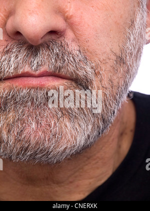 Extreme close up portrait of a serious looking man - Stock Photo