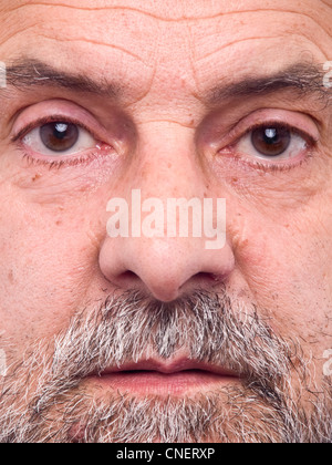 Extreme close up portrait of middle aged bearded man - Stock Photo