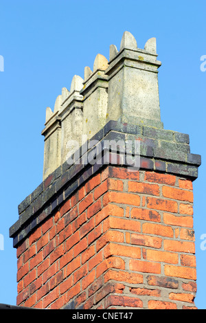 A row of chimney pots on a Victorian terraced house. - Stock Photo