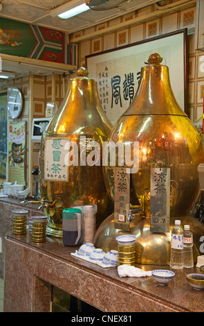 Traditional chinese kitchen with turtle soup pots - Stock Photo