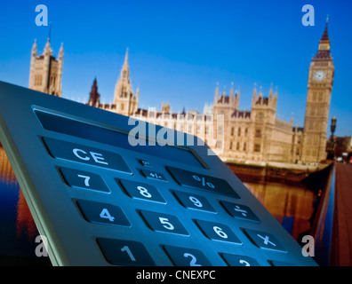 Concept image of calculator and Houses of Parliament in background Westminster London UK - Stock Photo
