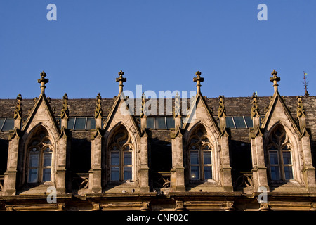 Sun reflecting shadows across rows of Scottish 1800`s Gothic style arched windows on an old listed building in Dundee,UK - Stock Photo