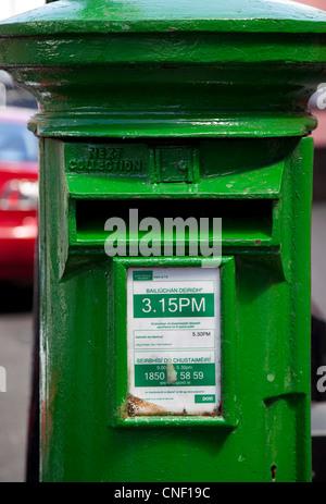 Irish Post Box in Dingle with Irish Language info. - Stock Photo