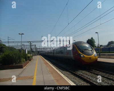 Virgin Trains Class 390 Pendolino No. 390001 'Virgin Pioneer' arriving at Watford Junction. - Stock Photo