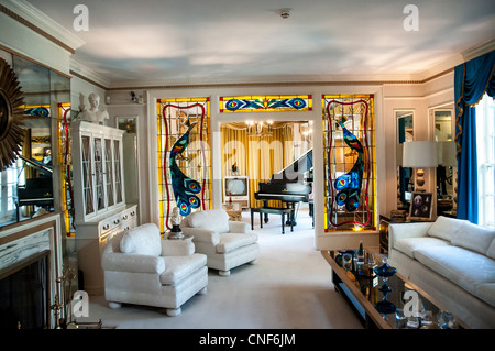 The living-room in Elvis Presley's home Graceland in Memphis Tennessee - Stock Photo
