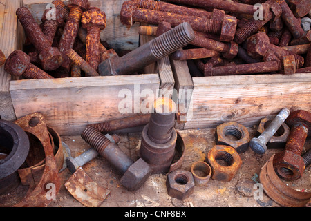 Boxes of old nuts and bolts - Stock Photo