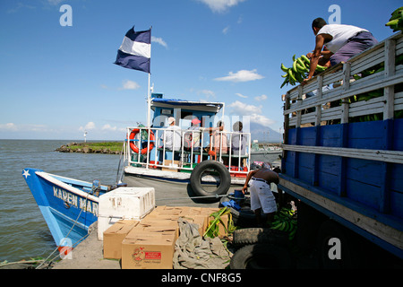 San Jorge Nicaragua ferry boat to Isla Ometepe on Lake Nicaragua Vulcano Concepciòn in background central latin - Stock Photo