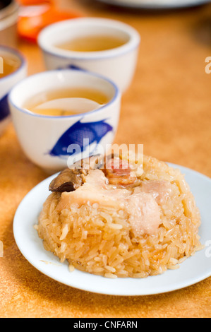 glutinous rice with chicken pieces, a common chinese food that serves in tea house, pronounce as 'Lo mai gai'. - Stock Photo