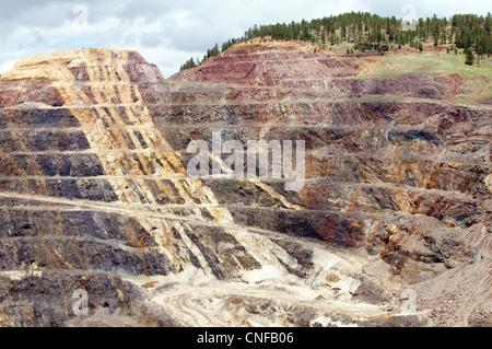 open pit gold mine lead south dakota sd industry mining landscape view appearance aspect composition contour - Stock Photo