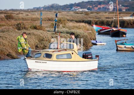Mariners enjoying the high tide at the popular resort of 'Morston Quay' on the 'North Norfolk' coast, UK - Stock Photo