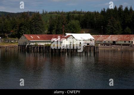 Old buildings on pilings along the inside passage near Kake, Alaska, USA - Stock Photo
