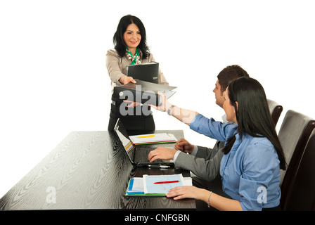 Manager woman giving folder to her employees in office - Stock Photo