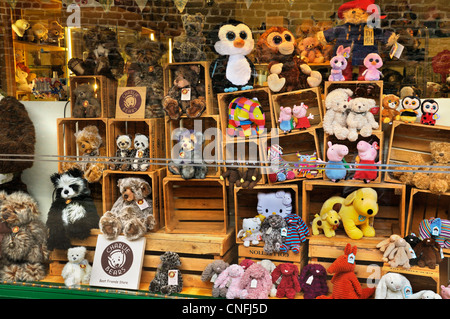 Cuddly toys in shop window display - Stock Photo