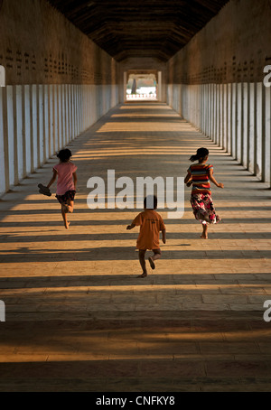 Burmese children walking in the corridor at Shwezigon Pagoda, Bagan. Burma. Myanmar - Stock Photo