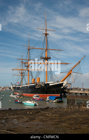 Portsmouth harbour looking towards HMS Warrior. The world's first ironclad warship - Stock Photo