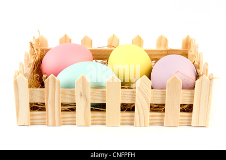 Basket of easter eggs on a white background - Stock Photo
