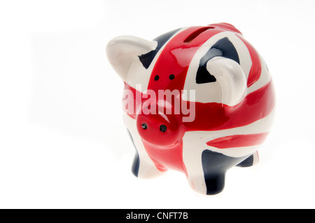 Piggy bank money box painted with a UK flag design 'Union Jack' - isolated against a white background - Stock Photo