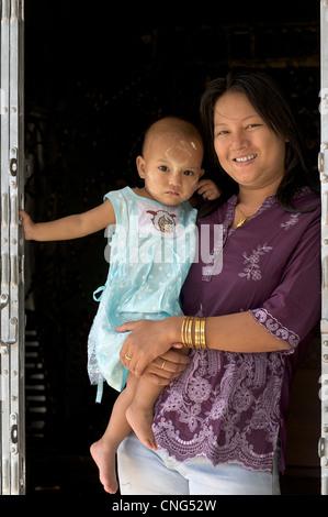 Burmese woman carrying young child, Pyin Oo Lwin, Burma. Myanmar - Stock Photo