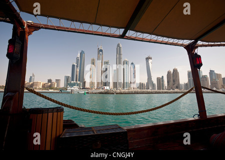 The skyscrapers of the 'Dubai Marina' area seen from a traditional dhow (Dubai - the United Arab Emirates) Gratte - Stock Photo