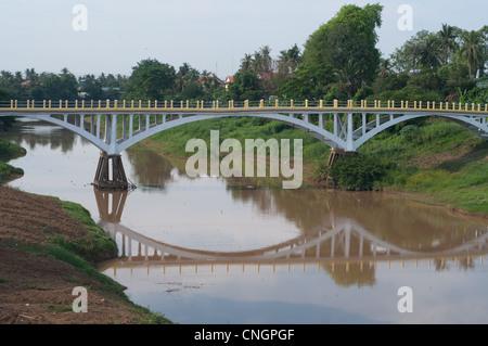 An old bridge over Stung Sangke River during dry season in Battambang, Cambodia - Stock Photo