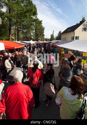 People at  Pestuumarkkinat street sales happening at Rautalampi Finland - Stock Photo