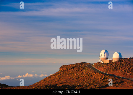 Sunset above the clouds over 3000 meters at the Haleakala Volcano, Maui, Hawaii - Stock Photo