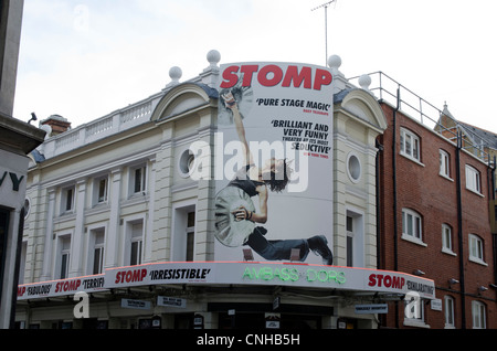 The New Ambassadors Theatre with billboard for Stomp the musical London Uk West street near Covent garden - Stock Photo