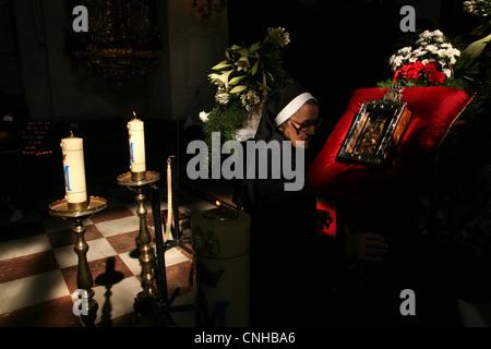 Catholic nun prays in front of the Palladium of Bohemia in Stara Boleslav, Czech Republic. - Stock Photo