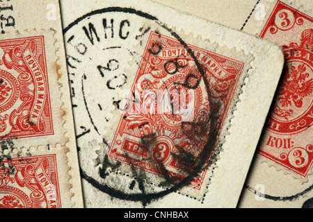 Old Russian postcards with two headed eagles in the stamps. - Stock Photo