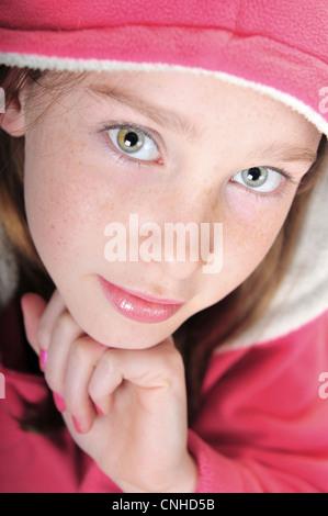 Pretty girl wearing pink hoodie - Stock Photo