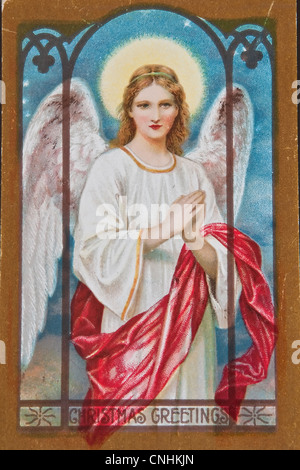 USA - CIRCA 1900 - This aged vintage postcard showing signs of wear, in a Christmas holiday angel with words Christmas - Stock Photo